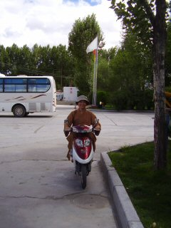 monk on scooter